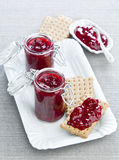 Jam with biscuits. Jam in a glass jar on a white plate with cookies Royalty Free Stock Image