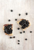 Jam with black currants on the toast Royalty Free Stock Image