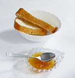 Jam bowl with plate of fresh bread Royalty Free Stock Photo