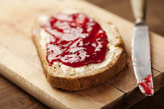 Jam on bread. Fresh bread with strawberry jam royalty free stock photos