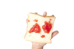 Jam and bread on hand Royalty Free Stock Photography
