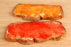 Jam bread. Two breads with apricot and strawberry jam Stock Photos