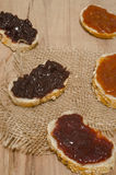 Jam on bread on wood. Background Royalty Free Stock Photos