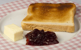 Jam, butter and toast. Royalty Free Stock Images