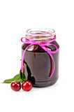 Jam cherry in a glass jar Stock Photography
