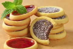 Jam  and chocolate filled tartlets Royalty Free Stock Images