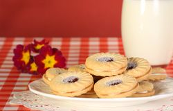 Jam and cream biscuits. Delicious jam and cream filled cookies or biscuits Stock Photography