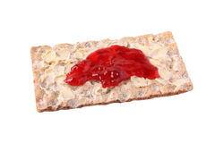 Jam on crisp bread Stock Image