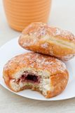 Jam donut with bite taken out Stock Image