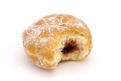 Jam doughnut with a bite taken over white. Jam doughnut with a bite taken out over white Royalty Free Stock Photos