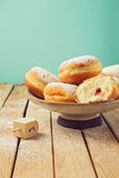 Jam doughnuts with icing sugar for Hanukkah holiday celebration stock photo
