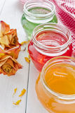 Jam and dried roses Stock Photography