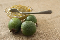 Jam from feijoa in a glass vase. On a linen background Stock Photos