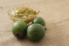 Jam from feijoa in a glass vase. On a linen background Stock Images