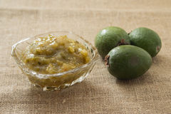 Jam from feijoa in a glass vase. On a linen background Royalty Free Stock Photography