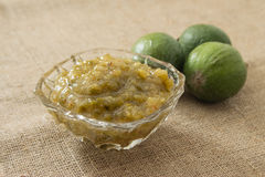 Jam from feijoa in a glass vase. On a linen background Royalty Free Stock Photos
