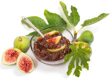 Jam of fig. Fig jam  in glass bowl and fruits with green leaves  on white background Stock Photography