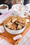 Jam filled bar cookies and cup of hot cocoa Stock Photo