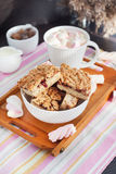 Jam filled bar cookies and cup of hot cocoa Stock Images