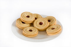 Jam filled biscuits. Some tempting looking jam filled biscuits on a plate Stock Images