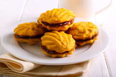 Jam filling biscuits on plate Royalty Free Stock Photos