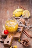 Jam from lemon. Jam of fresh ripe lemon in a glass container with flower royalty free stock image