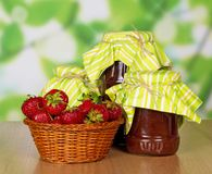 Jam and fresh strawberry in basket Royalty Free Stock Images