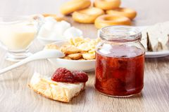 Jam in glass cann on wooden table Royalty Free Stock Photos