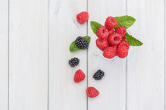 Jam glass filled with raspberries and a twig mint decorated with Royalty Free Stock Images