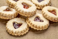 Jam heart biscuits on burlap canvas stock photos