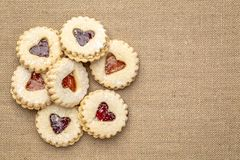 Jam heart biscuits on burlap canvas royalty free stock images