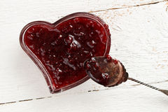 Jam in heart  shaped glass dish Royalty Free Stock Photo