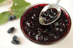 Jam of honeysuckle. In glass bowl and berries stock image