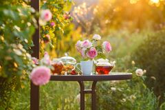 Free Jam In Glass Jar. Romantic Dinner In The Garden Under A Rose Bush. Summer Time. Copy Space Stock Image - 180433111