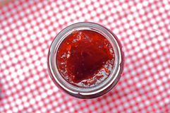 Jam Jar. On gingham table cloth Stock Photo