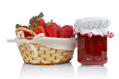 Jam Jar And Strawberries Stock Photos
