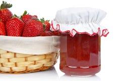 Jam jar and basket of strawber Royalty Free Stock Photo