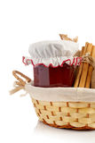 Jam jar, cinnamon in a basket Royalty Free Stock Photography
