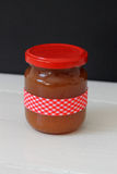 Jam in jar. Jam in a jar decorated with a red plaid ribbon Stock Photography