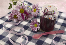 Jam jar with flowers Royalty Free Stock Photo