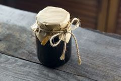 Jam jar. Vintage wooden nackground royalty free stock photo