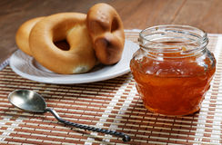 Jam jar and pretzel on the table Royalty Free Stock Photos