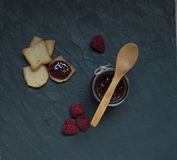 Jam jar with raspberry jam and bread Royalty Free Stock Photo