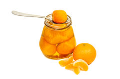 Jam in jar with spoon and mandarin. Isolated on white background royalty free stock photos
