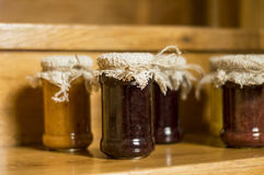 Jam jar whit jams. Jam jars whit jams on rustic background Royalty Free Stock Photo
