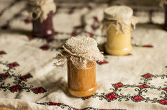 Jam jar whit jams. Jam jars whit jams on rustic background Royalty Free Stock Photography