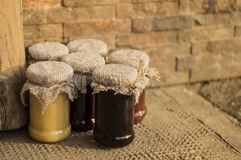 Jam jar whit jams. Jam jars whit jams on rustic background Stock Image