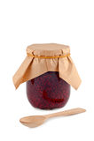 Jam in jar, wooden spoon. royalty free stock photography