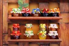 Jam jars arranged for sale Royalty Free Stock Photos