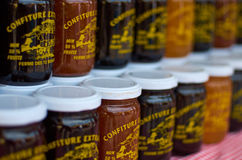 Jam in jars. Artisanal jam being sold at a small French market stock image